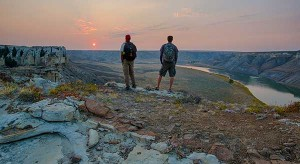 Two people look out over the Upper Missouri Breaks NM. - CC License - Bob Wick